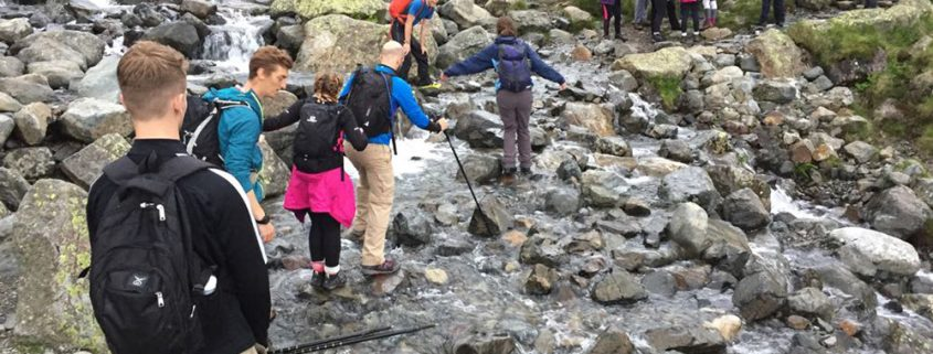 Boomerang team doing 3 peaks challenge, crossing a river