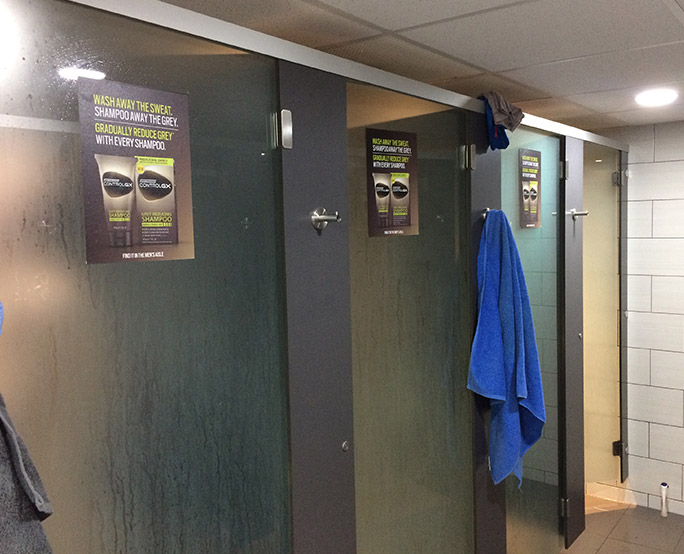 Just for men ambient advertising outside changing room showers
