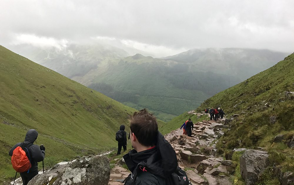 Boomerang team climbing mountain in the 3 peaks challenge
