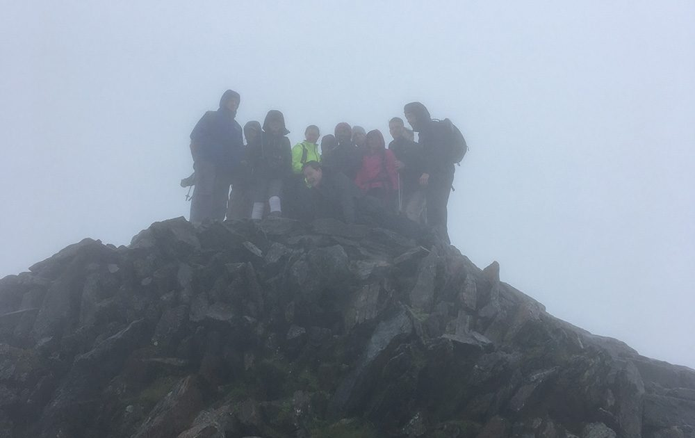 Boomerang team doing 3 peaks challenge in fog